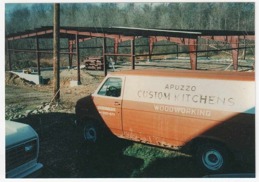 Shown here is the first official Apuzzo Kitchens van right in front of the foundation and framing of the woodshop!