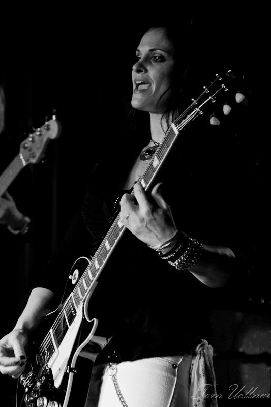 "Lisa Addario   Lisa plays the part of Joe Perry, who is known for his down and dirty raw guitar style and signature tones. She brings the songs to life with an authentic tone and delivers the goods. From the ever-so- recognized Talk Box in ""Sweet Emotion"", the killer slide work in ""Draw the Line"", to the foot stomping live performance of four decades of hit songs, Lisa delivers with passion. Photo Tom Eullener"