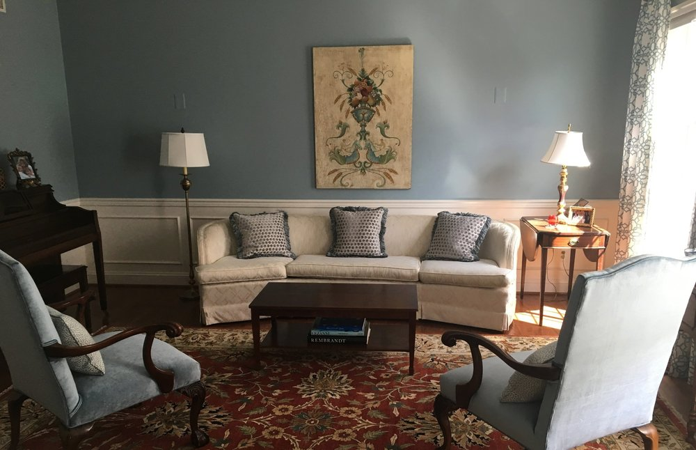 The walls of the formal living room were painted to match the blue in the drapery. The chairs were recovered in a beautiful velvet and coordinating custom pillows were made for both the sofa and chairs.
