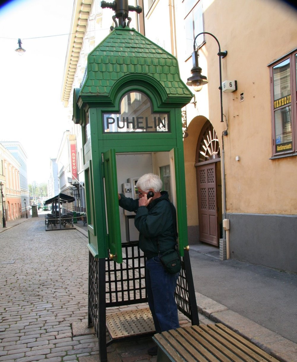 Jim doing one more deal in an operating antique phone booth