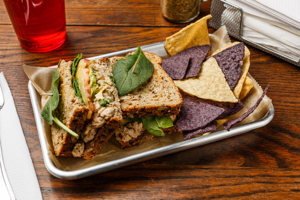 Earthquake  Tuna salad, avocado, green onions, tomato, Monterey Jack cheese, spinach, mayo, and spike seasoning. Made as a wrap, sandwich, or salad. Served with organic tortilla chips.   $7.49