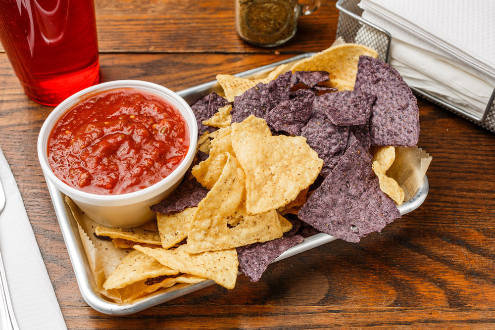 Chips & Salsa  (8 oz.) Salsa served with blue and white organic tortilla chips.  $6.49