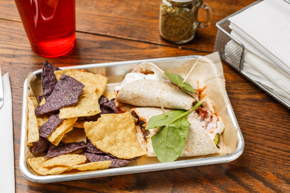 Black Bean Burrito  Organic whole wheat tortilla, black beans, sour cream, avocado, and salsa. Served with organic tortilla chips.  $6.49