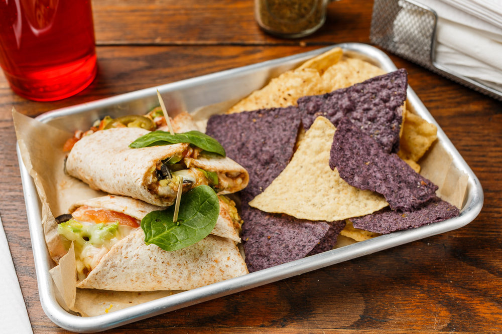Mucho Burrito  Organic whole wheat tortilla, black or pinto beans, cream cheese, avocado, green onions, tomato, black olives, jalapeño, Monterey Jack cheese, and salsa. Served with organic tortilla chips.  $7.49