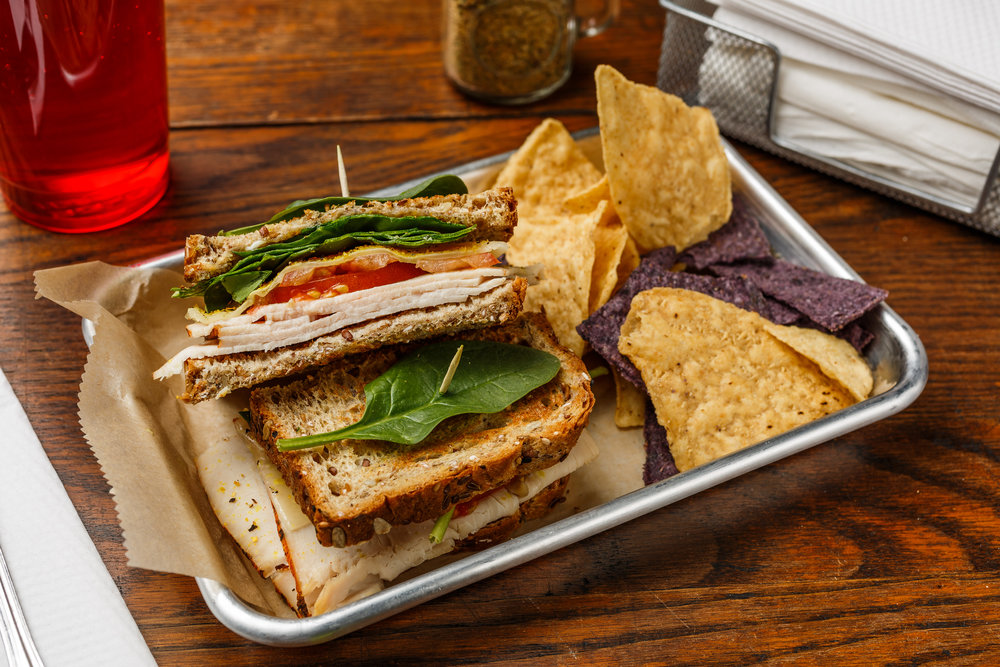 T-n-T  Boar's head turkey, tomato, Swiss cheese, spinach, mayo, and lemon pepper. Made as a wrap, sandwich, or salad. Served with organic tortilla chips.  $6.49