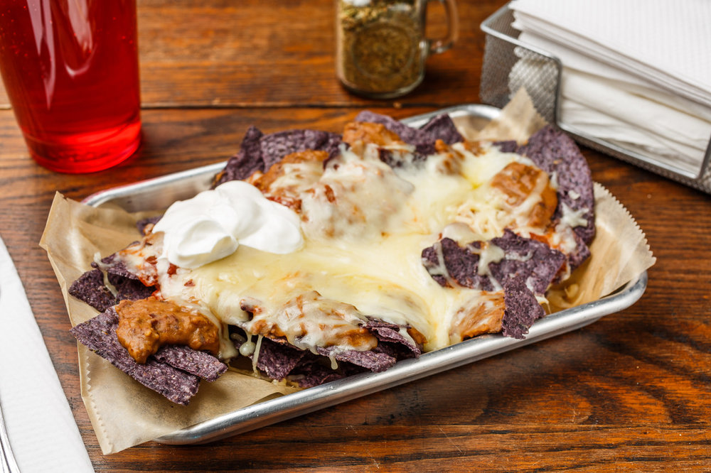 Nachos  Organic blue corn chips, pinto beans, sour cream, salsa, and Monterey Jack cheese..  $7.39