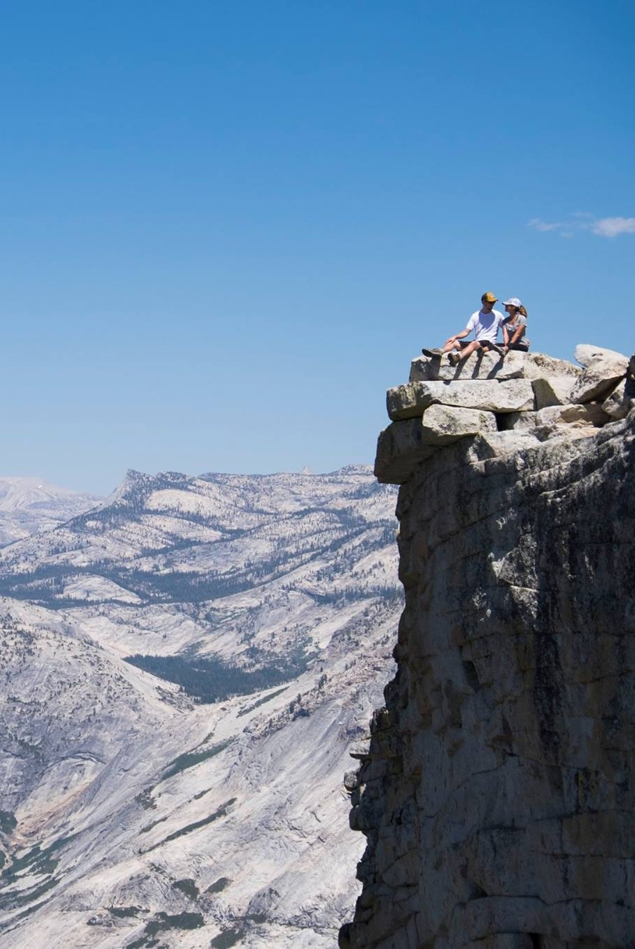 Half Dome, Yosemite2016 - This is us enjoying a triumphant rest on the mountain peak. Without any prep we relied on our dwindling reserves of youthful energy and hiked over 16 miles on this very long day. We probably won't do this again anytime soon, so I'm glad we got some photo evidence to show our future kids.