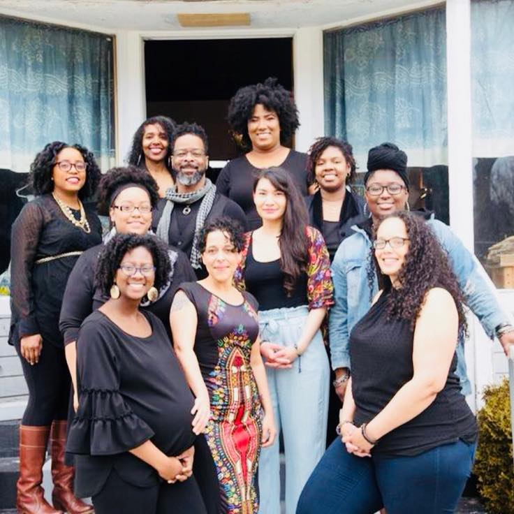 Jessica Roach is pictured above (center-left) with  ROOTT , a Black-woman led reproductive justice organization.