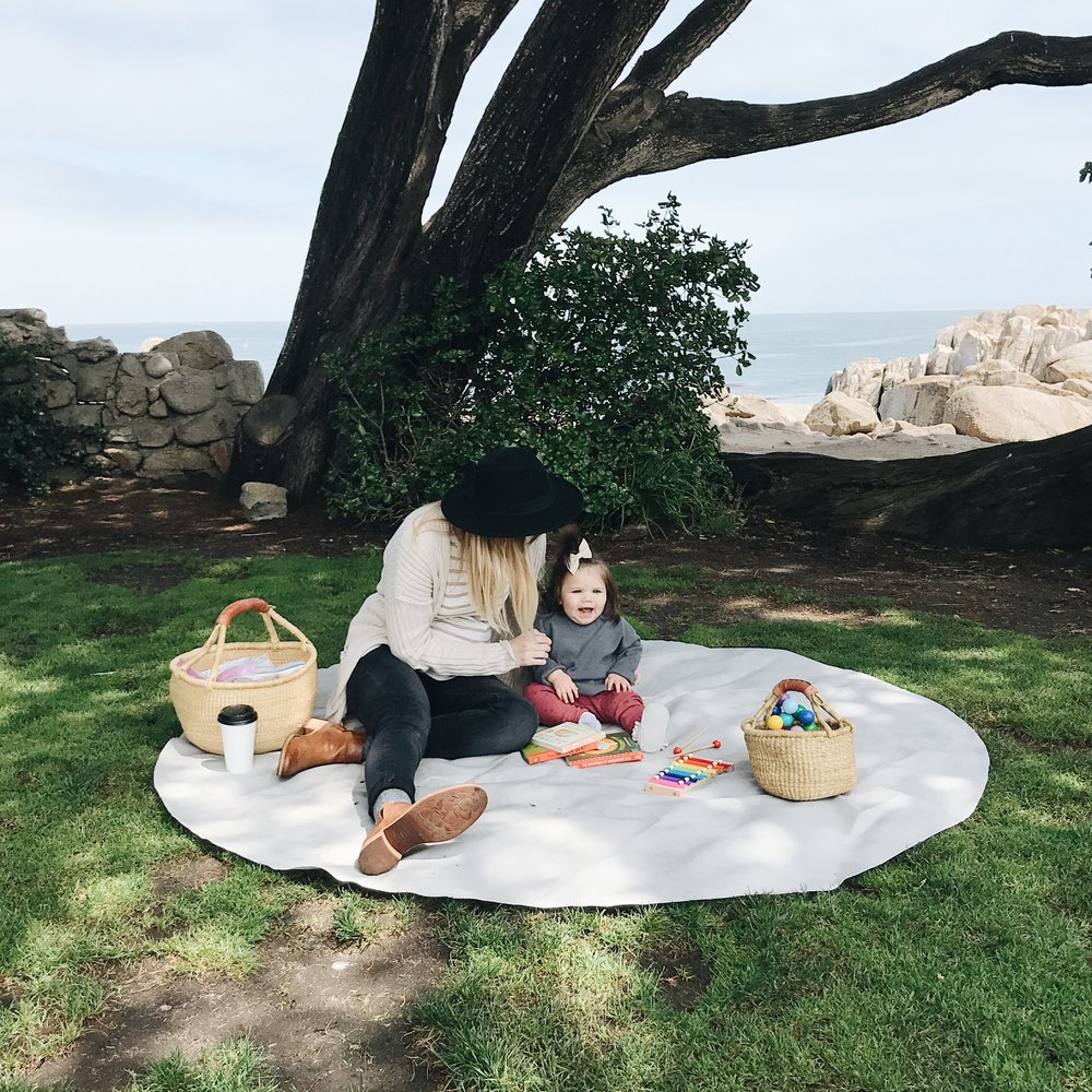 Being honest... this ocean view picnic lasted five minutes. Squirrels were literally coming up to us on the mat and trying to take pretzels out of Nora's hand! It was insane and none of my shooing did any good. So we packed up and left lol.