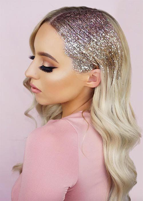 hair glittering - Spraying festive glitter in any hair style, such as a bun, ponytail, or the roots of a fresh blow dry can make an extremely easy look, look festive as ever.