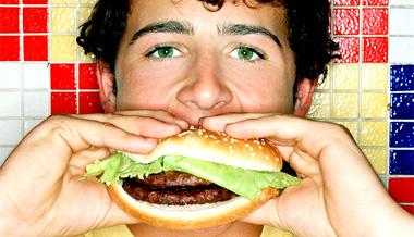 male-eating-hamburger-junk-food.jpg