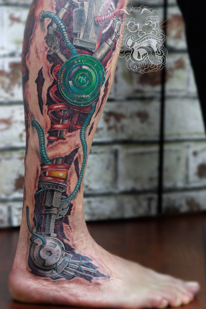 3d biomech tattoo - close up view. In the center of attention in this tattoo exist one of my favourite elements - digital clock. I especially put contrast on it using green color, that goes towards the viewer against other elements done mostly with warm tones.