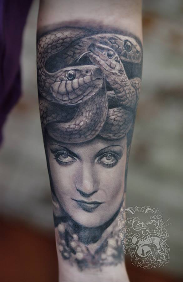 For this Medusa black and grey tattoo, I used the old picture of an actress. When looking for a beautiful face, I find out that often it is easier going back in time. In the middle of the last century, lightning photo scene was much more interesting than today.