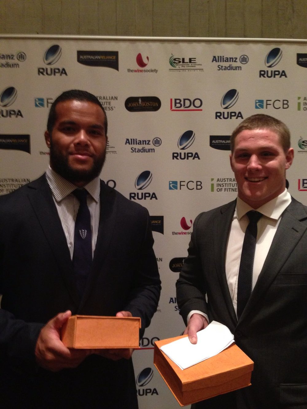Founder Eddie Aholelei receiving the RUPA award for Service to the Community alongside Australian Wallabies captain Michael Hooper