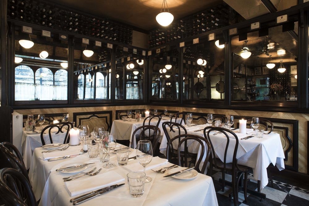 Cafe St Honore room set with candles.jpg
