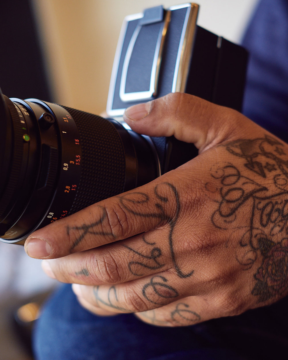 hasselblad cameras and hands with tattoos