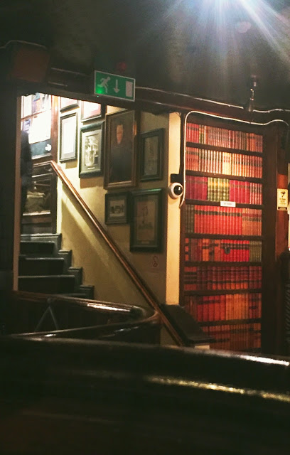 Just your average pub with a fake library wall door! It actually goes to the ladies room