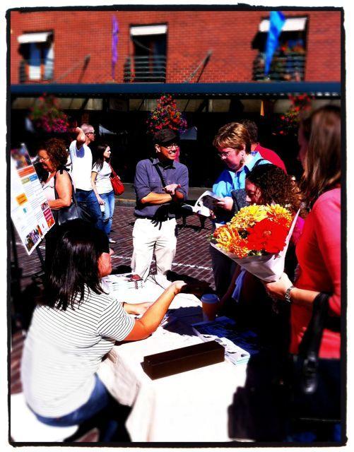 "Amy Pennington signing copies of her book, ""Urban Pantry"""
