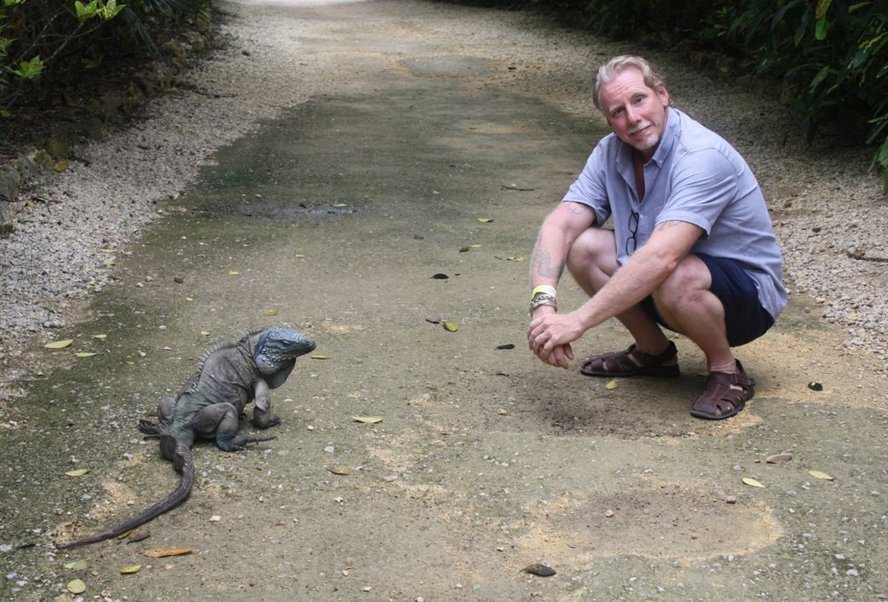 Nick and a Blue Iguana on Grand Cayman Island