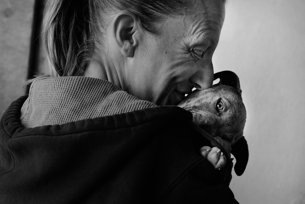 "Michelle with her 2-month-old puppy Missy. ""If you can't care for yourself you shouldn't take on a dog,"" Steve says, but adds that the dog helps Michelle cope with the stress of living on the streets. June 20, 2017."