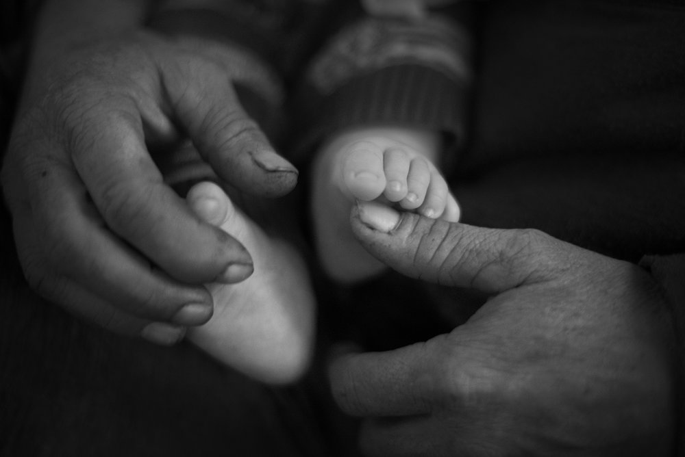 """I used to play with Chad's feet like this for hours when he was a baby,"" said Steve, as he cradles his grandson's feet."