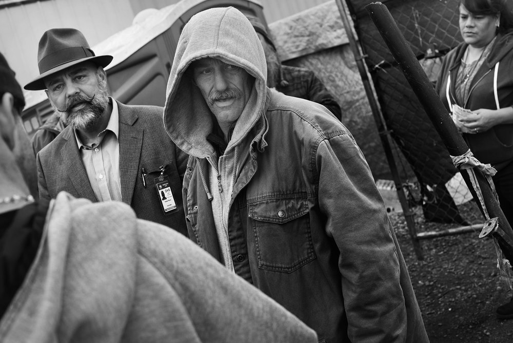 As homeless camp manager Steve is a liaison between health officials and the homeless campers. On this Monday morning he escorts Rafael Reyes, left, from Sonoma County Department of Health Services and Anna Branzuela, right, with the California Department of Public Health, who are passing out flyers announcing free STD screenings. January 29, 2018.