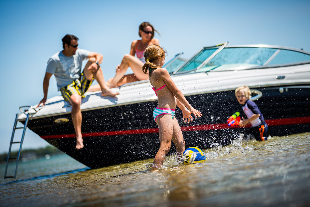 Family playing in water next to boat-X3.jpg