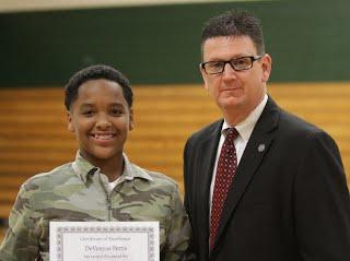 Superintendent Dr. Stephen Fisher and Seventh-grader DaVonyae Pettis