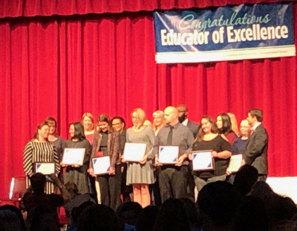 Front Row, Fourth from the Left: Heather Parker, EC Teacher of Excellence, recognized among others for her accomplishment.