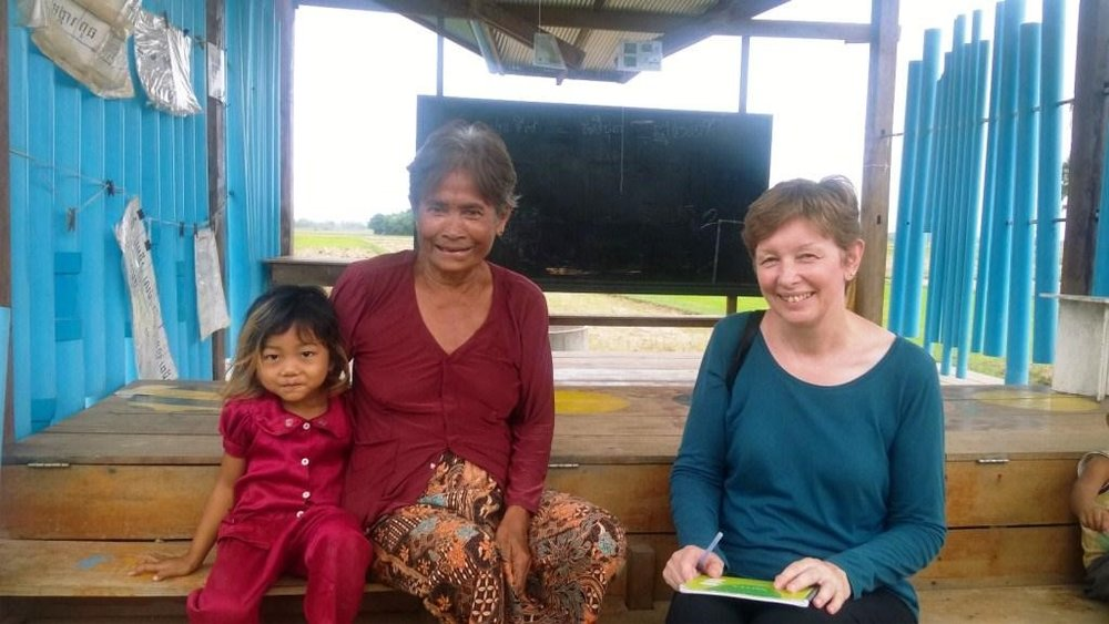 From right to left, Ms. Rosemary Hurley   (volunteer), Grandma Thorn Ma and Samna (preschool student-granddaughter).  This photo was taken during the interview at CCAFO Preykralar Khangkloeut Village Based Preschool during the first week of April 2014.  Photo by Hing Channarith.