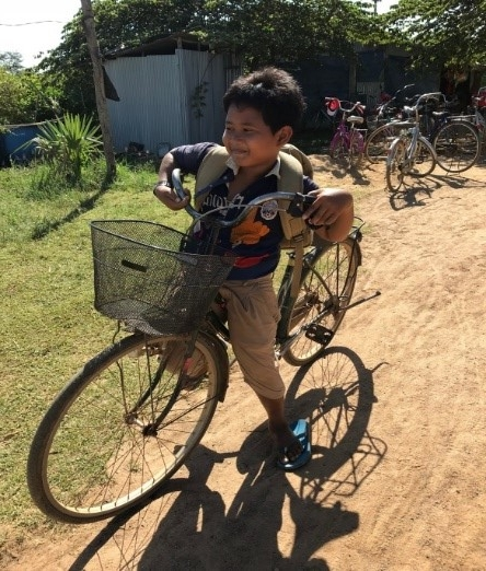 Channy with his bike, after class at the CCAFO English Language Center