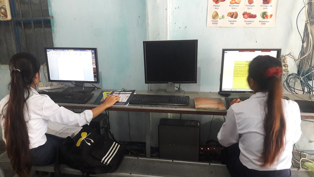Image: Students participate in morning basic computer class.