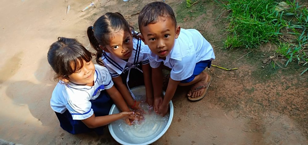 Photo:  At Paurn Village Based Preschool, students wash their hands before eating nutritiouse meals