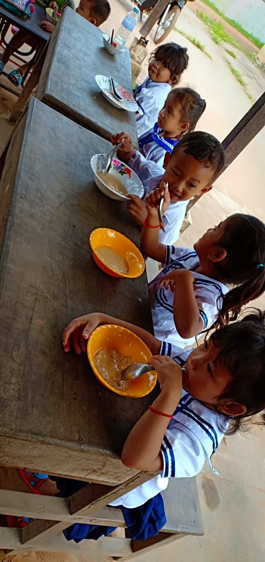 Photo:  At Paurn Village Based Preschool, students eat nutritiouse meals before leaving school at 9:00AM.