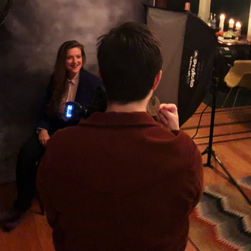 Capturing a professional headshot at the QueerCut portrait party.