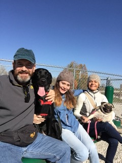 Family who took private sessions with their Lab/Bermese mix, Luna.