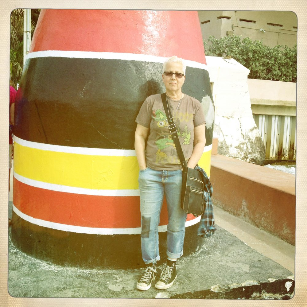 Lucky's founder, Rae Stang, next to The Southernmost Point Buoy in Key West, Florida (2013)