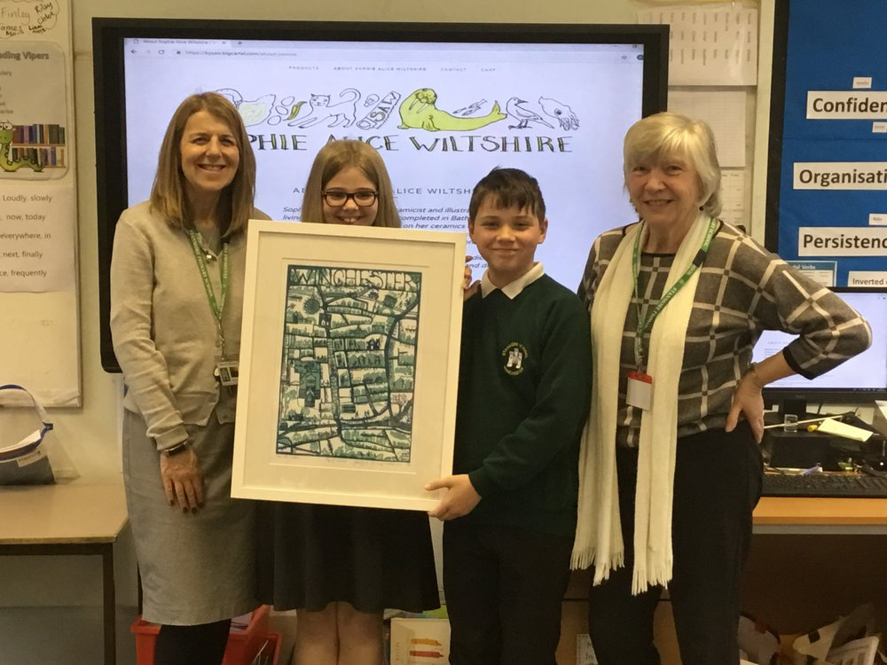 Mrs Taylor and pupils receiving a print of Winchester from Mrs Pam Meir.