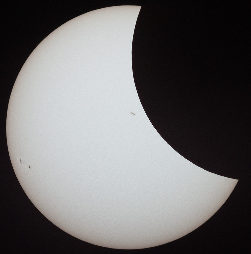 Partial Eclipse featuring sunspots 2671 and 2672