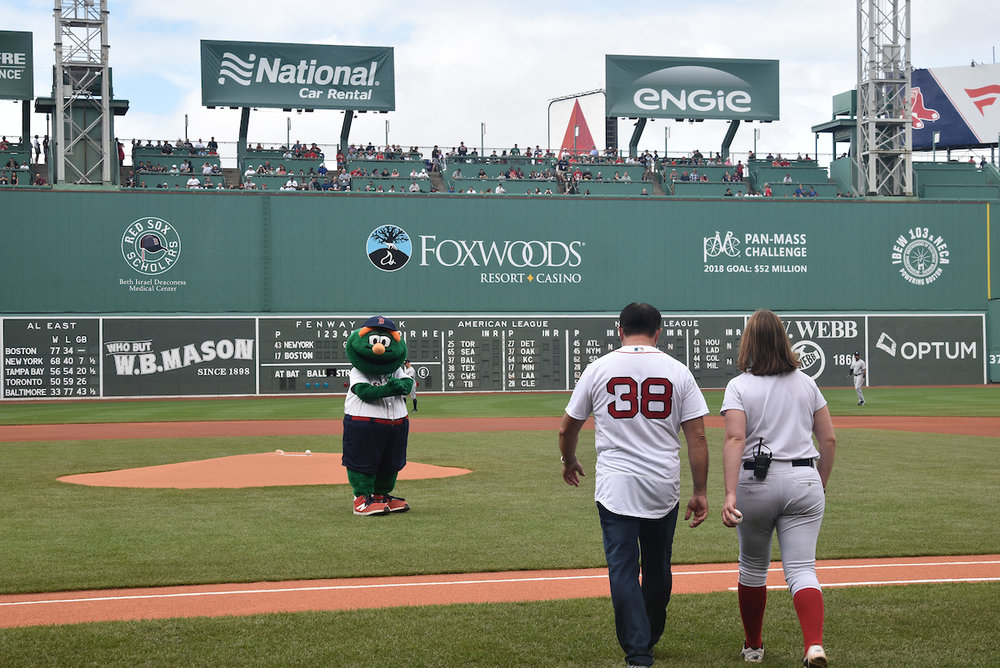 Howard is escorted to the pitchers mound in historic Fenway Park