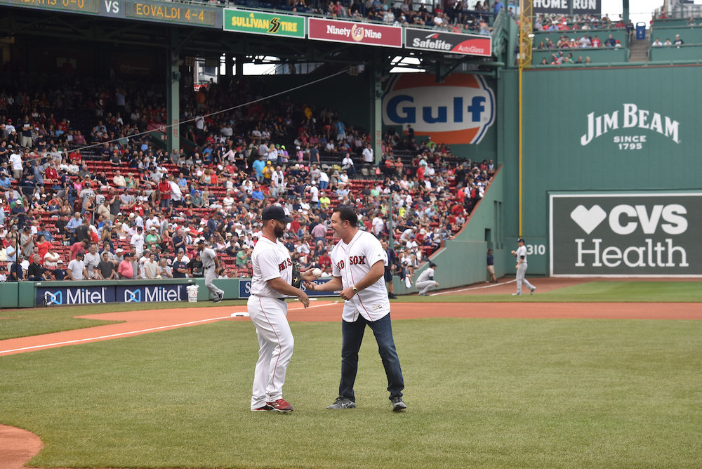 Howard receives commemorative baseball from Red Sox catcher, Dan Butler
