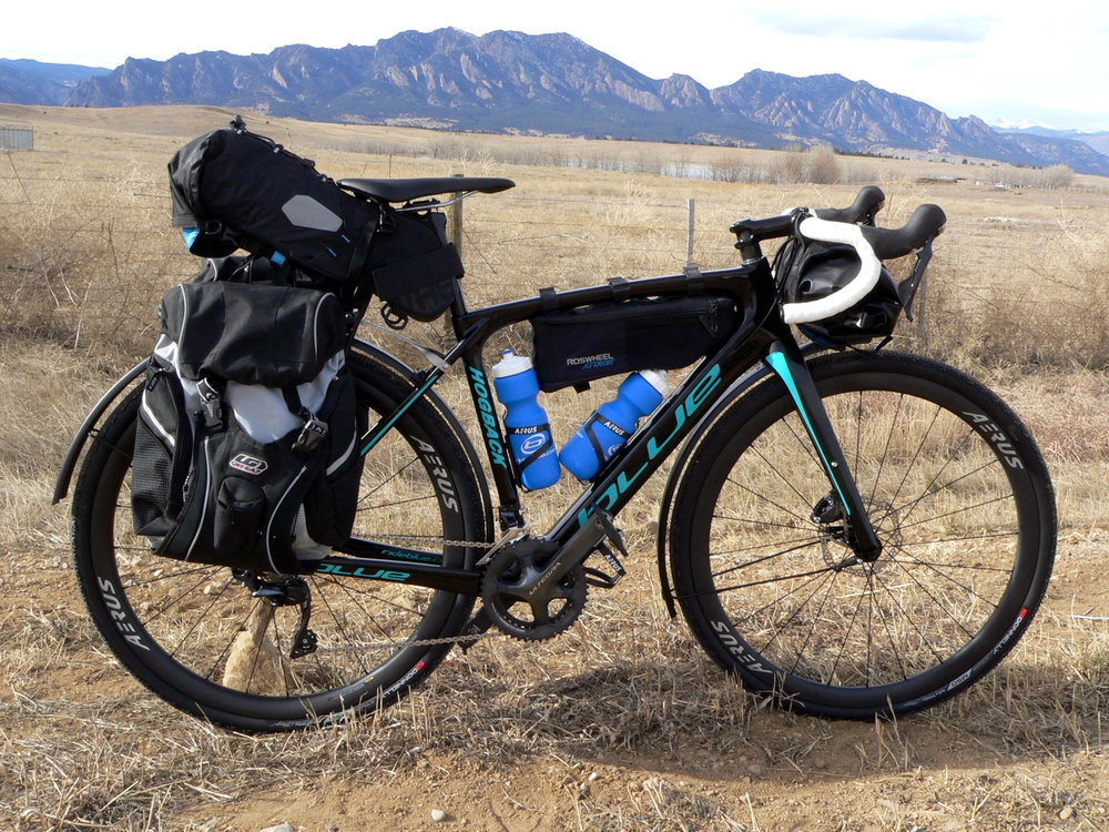 Designed be stable fully loaded and to handle all your bike-packing and adventure riding with fender mounts, front and rear rack mounts and a third water bottle mount.