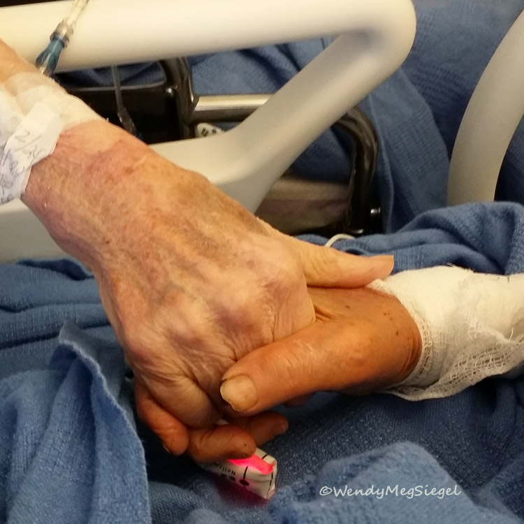 My parents holding hands during one of my mom's visits to my dad's hospital room. The wonderful hospital staff helped make sure they visited one another every day.