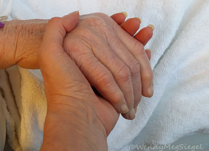Holding my Mom's hand just hours before she died.