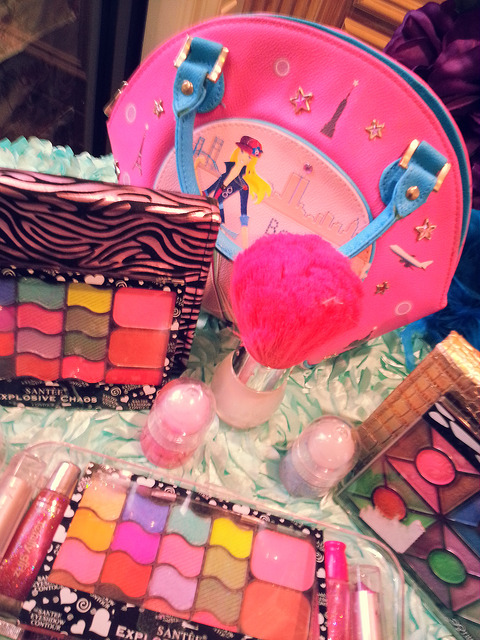 Make-up station includes table, linen, nail polish, and kid friendly cosmetics for kid friendly make overs.