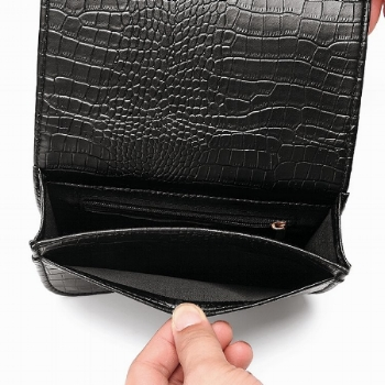 The fashionable    'Allie Hip Purse by White Rhino Bags    is a great example of a vegan leather product that recreates the chic appearance and textured feel of alligator leather without any of the guilt. Available in Black and Red at $22.00.