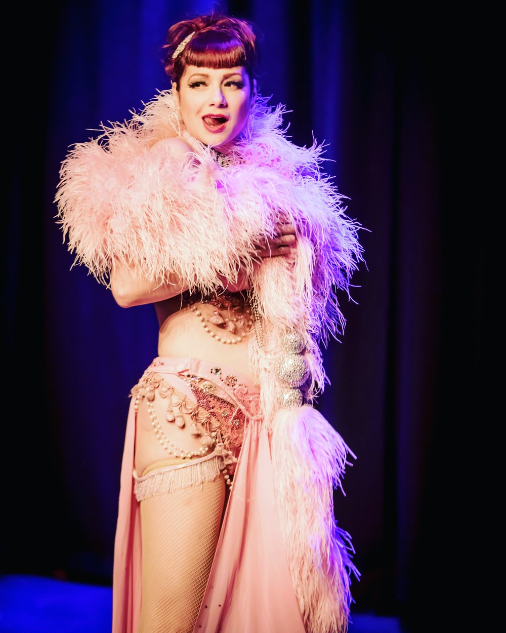 "showgirl - With over 11 years of professional Burlesque experience honed across 16 countries, and using the skills which gained her ""Burlesque Royalty"" status at the 2011 Burlesque Hall of Fame ""Miss Exotic World"" contest in Las Vegas, Anna can customize her enviable repertoire of classic-costumed acts, for your private and corporate events. For this, Anna will work with you to create a custom performance perfectly-suited to your audience and venue."