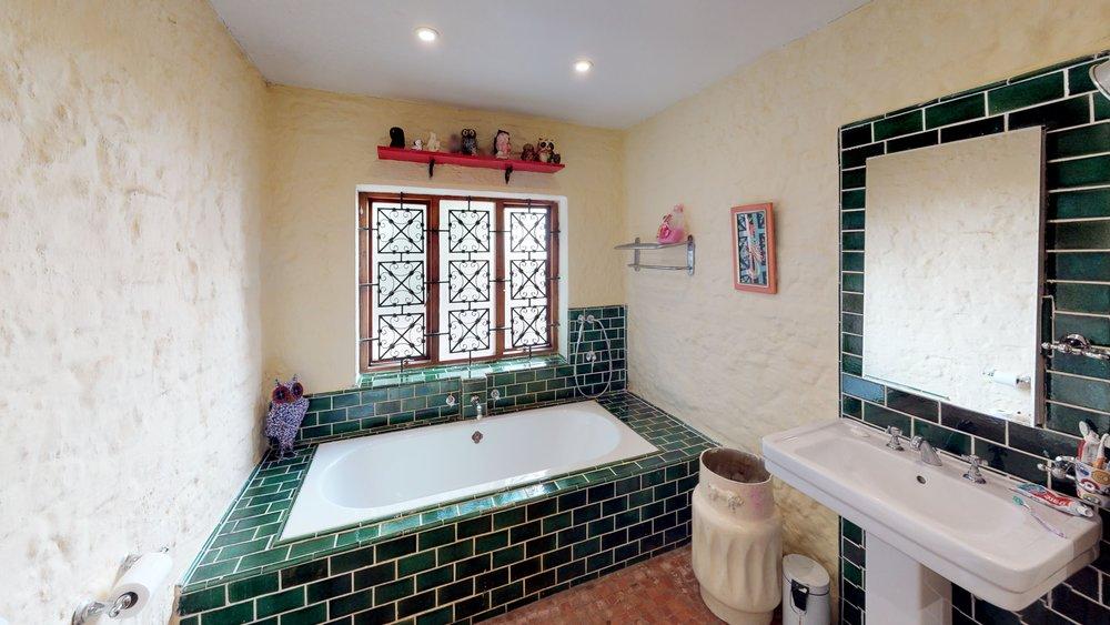 Melville bathroom green tiles.jpg