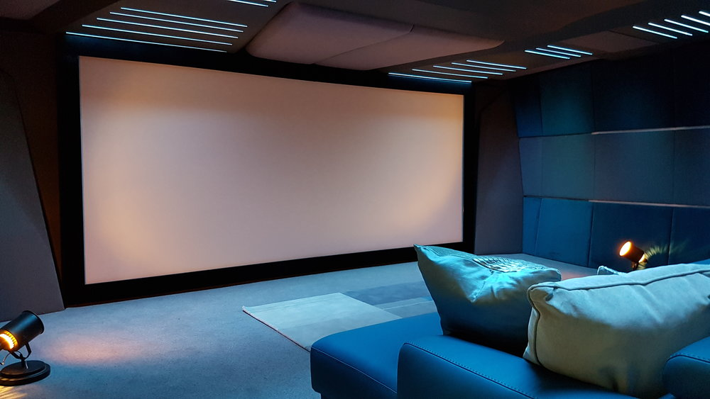 Tailored to You - Projection screens can be constructed bespoke to fit your space, we will advise on the optimum width for your desired viewing distance. For a multi-purpose room the projection screen can even motorise out of a trap-door in the ceiling, leaving it completely hidden when not in use and elegantly descend when viewing commences.