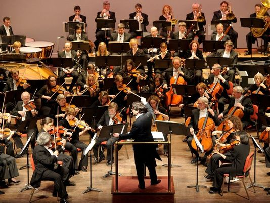 Delaware Symphony Orchestra being directed by David Amado in recent years.